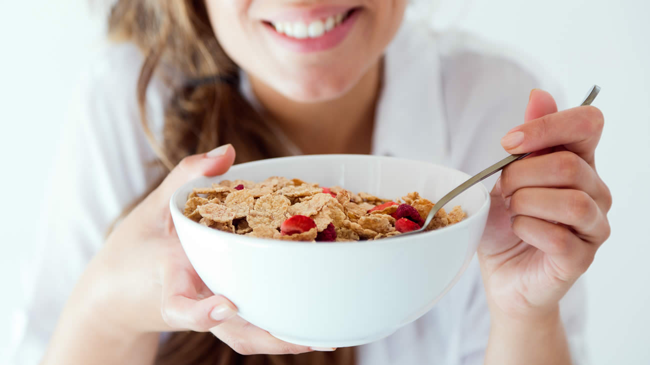 Eating a bowl of cereal with strawberries